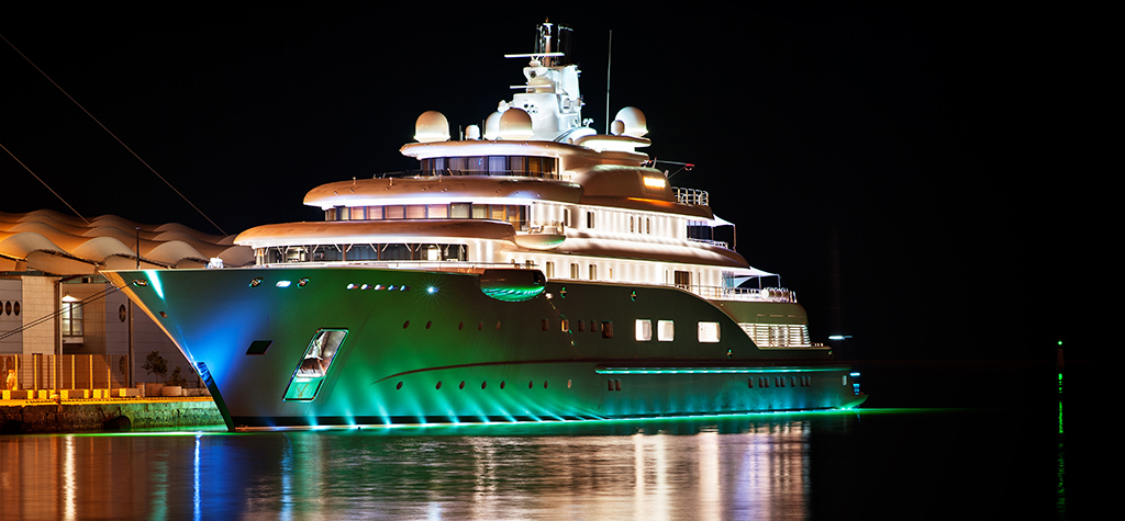 Luxury yacht moored in the harbour at night